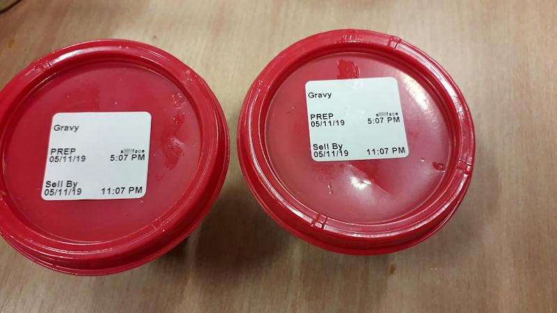 "Picture of the gravy Karl Cooper received from the KFC, where staff wrote ""s**tface"" on the lid."