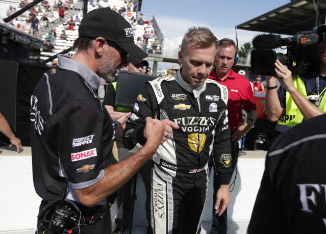 Ed Carpenter bumps fist with a member of his crew after he qualified for the IndyCar Indianapolis 500 auto race at Indianapolis Motor Speedway in Indianapolis, Saturday, May 19, 2018. (AP Photo/Michael Conroy)