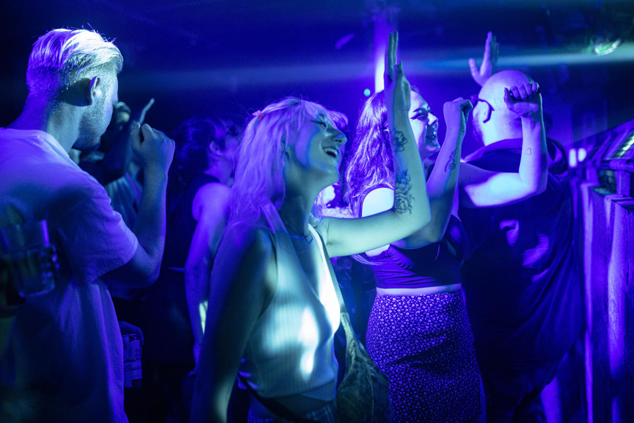 LONDON, ENGLAND - JULY 19: People dancing at Egg London nightclub in the early hours of July 19, 2021 in London, England. As of 12:01 on Monday, July 19, England will drop most of its remaining Covid-19 social restrictions, such as those requiring indoor mask-wearing and limits on group gatherings, among other rules. These changes come despite rising infections, pitting the country's vaccination programme against the virus's more contagious Delta variant. (Photo by Rob Pinney/Getty Images)