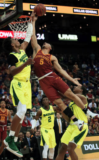 Baylor forward Freddie Gillespie (33) blocks a shot by Iowa State guard Lindell Wigginton (5) during the first half of an NCAA college basketball game in the quarterfinals of the Big 12 conference tournament in Kansas City, Mo., Thursday, March 14, 2019. (AP Photo/Orlin Wagner)