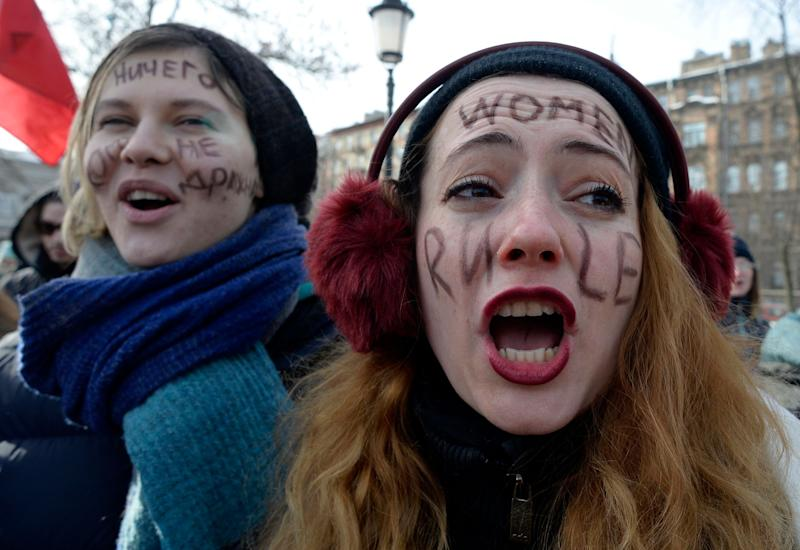 Feminists take part in a rally for gender equality and against violence toward women.