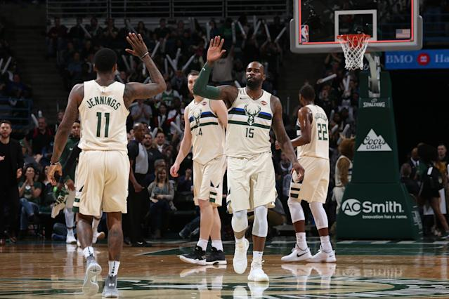 Milwaukee, WI - APRIL 9: Shabazz Muhammad #15 of the Milwaukee Bucks and Brandon Jennings #11 of the Milwaukee Bucks high five during the game against the Orlando Magic on April 9, 2018 at the BMO Harris Bradley Center in Milwaukee, Wisconsin. (Photo by Gary Dineen/NBAE via Getty Images)