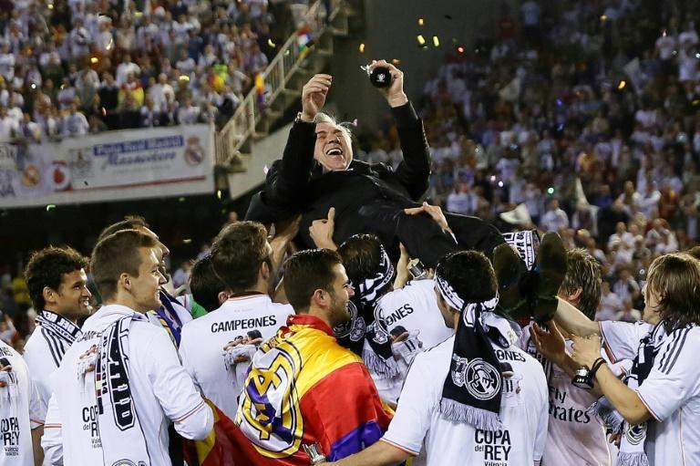 Popular choice: Real Madrid players hoist Carlo Ancelotti into the air after beating Barcelona in the 2014 Spanish Cup final
