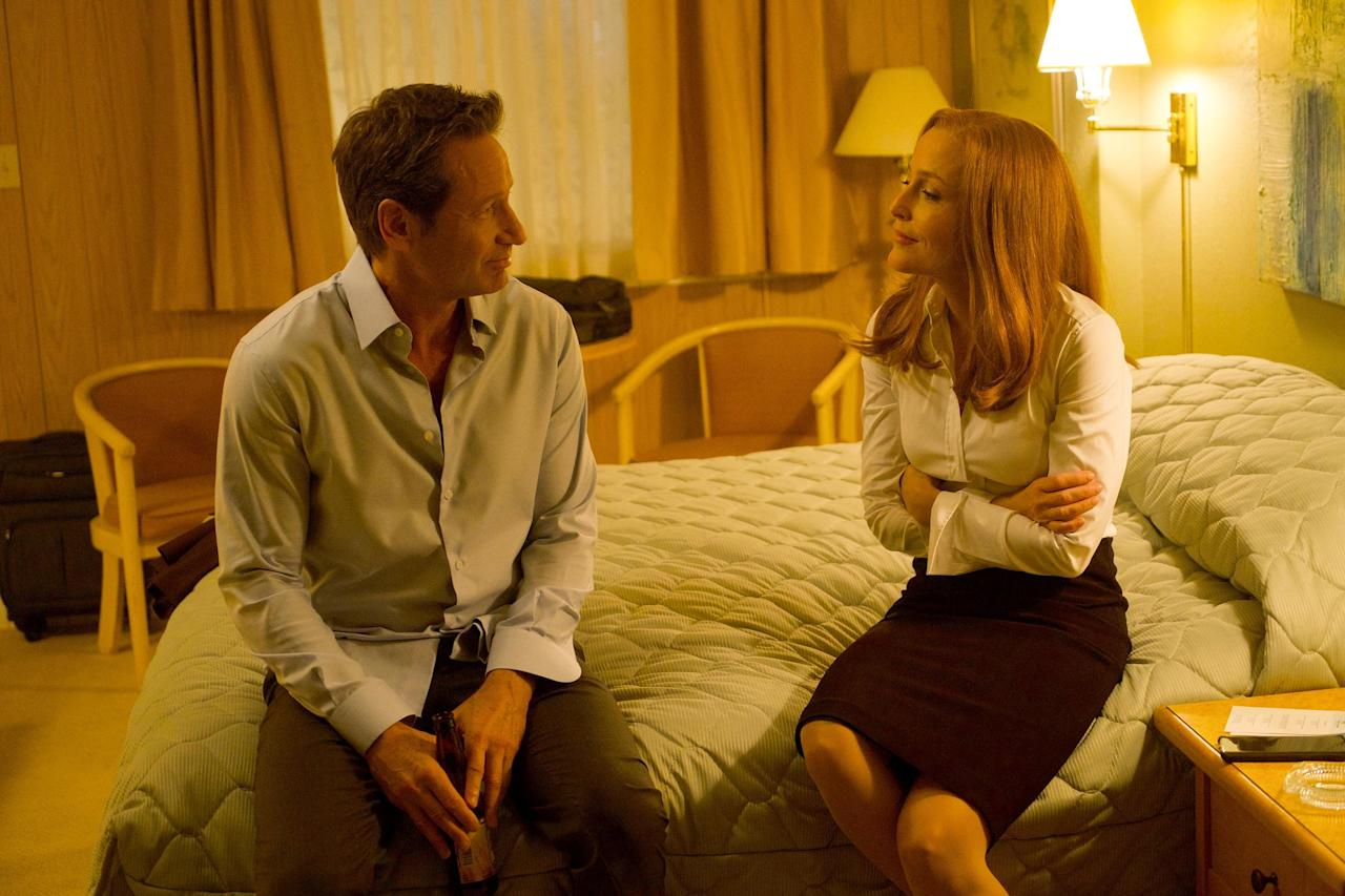 """Maybe seeing Mulder and Scully in bed together shouldn't be such a big deal after 25 years and a child (or two), but<i>The X-Files</i> is stingy with the good stuff — so stingy, in fact, that last year, """"that split second in the <i>X-Files</i> promo where Mulder and Scully are in bed together"""" made our list of <a href=""""https://ew.com/tv/shipper-moments-2017/"""">unforgettable shipper moments</a>. This year, that """"split second"""" unfolded in all its glory. In a motel with a convenient shortage of rooms, Scully sought comfort in Mulder's bed for the first time since the 2008 movie, and they talked about growing old together (even their pillow talk is bittersweet). But the second time was just plain sweet: The hour ended with Scully knocking on Mulder's door to find him waiting for her on the other side. —<i>Kelly Connolly</i>"""