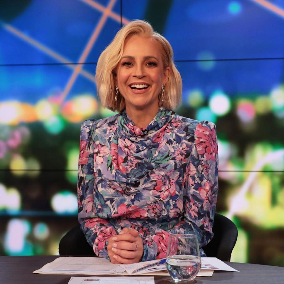 Carrie Bickmore wearing a pink and blue floral dress on The Project set. Photo: Channel 10.