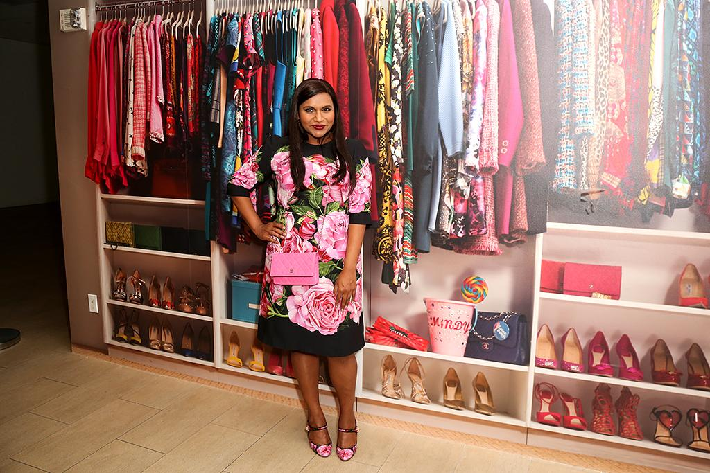 "<p>At the preview of a new exhibit, ""<i>The Mindy Project</i>: Six Seasons of Style,"" at the Paley Center in L.A., the show's creator and star posed with some of the colorful fashions that Mindy Lahiri has worn. The man behind those looks, costume designer Salvador Perez, said that while the expectant Kaling isn't showing yet, he's already ""buying lots of stretch."" (Photo: Paul Archuleta/Getty Images) </p>"
