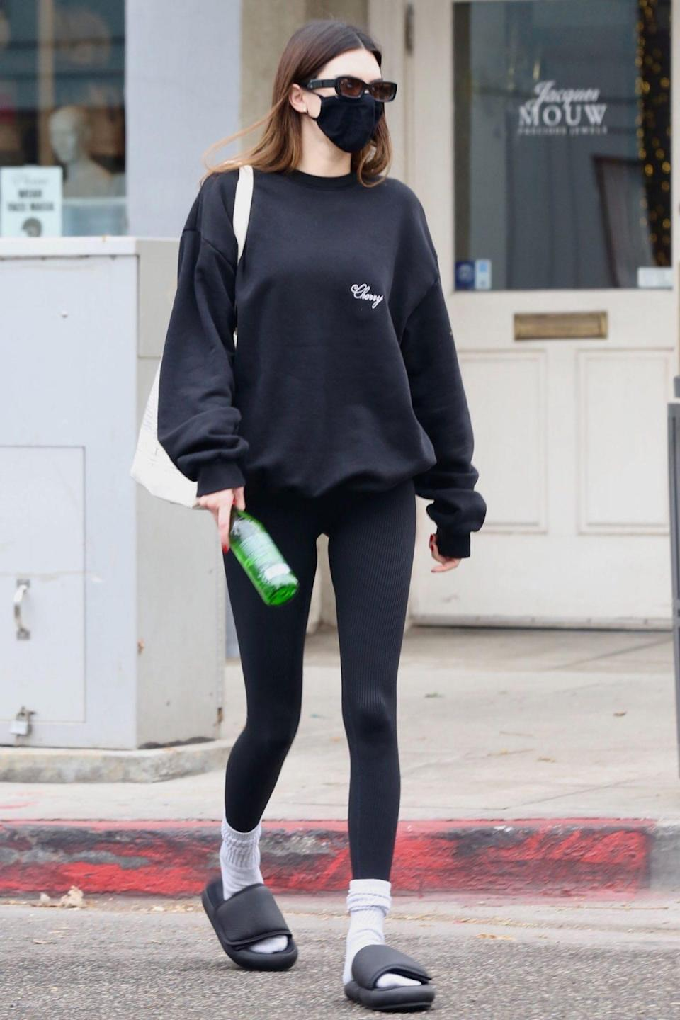 <p>Kendall Jenner is seen leaving lunch with friends in black leggings and a sweatshirt on Monday in Beverly Hills. </p>