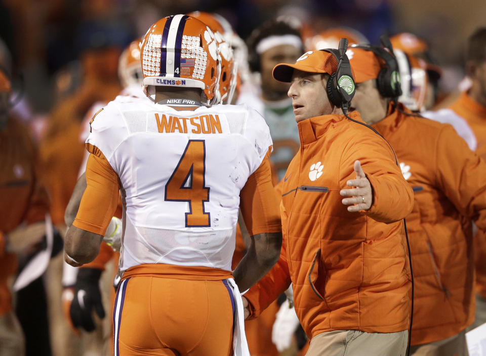 Clemson coach Dabo Swinney, right, congratulates Deshaun Watson