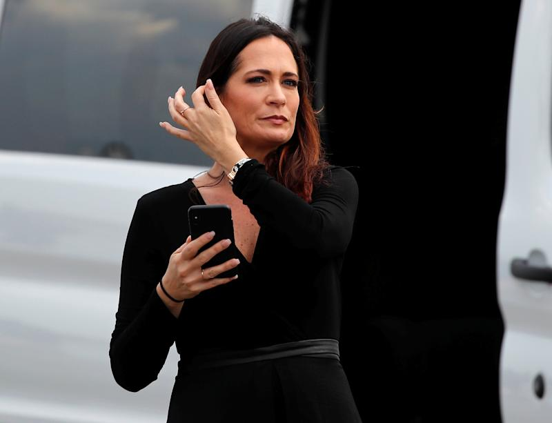 Stephanie Grisham, spokesperson for first lady Melania Trump, waits by a van after her arrival for a Donald Trump campaign rally in Orlando, Fla., on June 18, 2019. (Photo: Carlos Barria/Reuters)