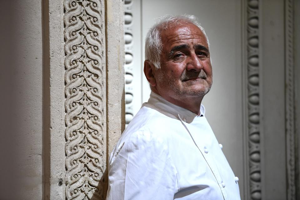 French chef Guy Savoy poses outside his Guy Savoy restaurant at La Monnaie de Paris in Paris on May 19, 2020. (Photo by Christophe ARCHAMBAULT / AFP) (Photo by CHRISTOPHE ARCHAMBAULT/AFP via Getty Images)
