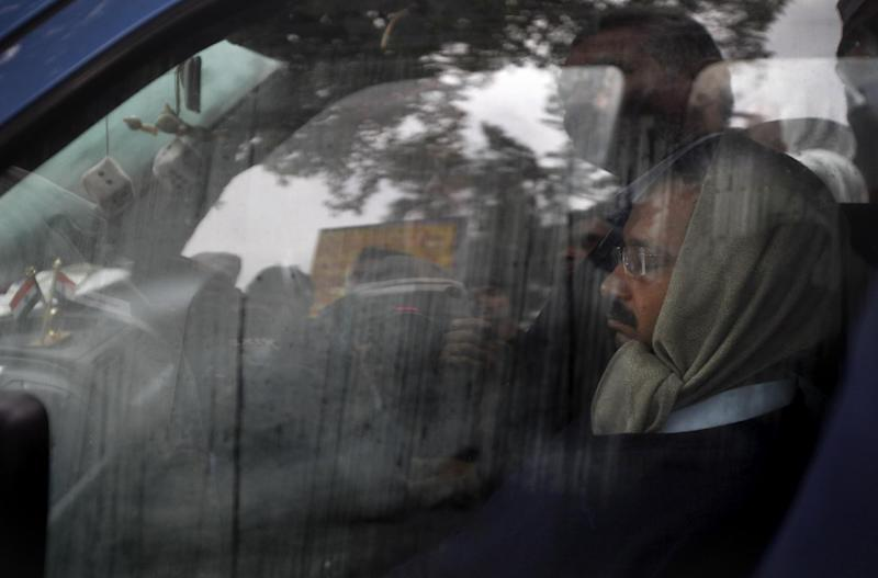 New Delhi Chief Minister Arvind Kejriwal, right, rests inside his Indian-made Maruti WagonR car during a demonstration against the police in New Delhi, India, Tuesday, Jan. 21, 2014. For a decade, Kejriwal has tilted at India's many windmills. He has led protests and hunger strikes against government corruption.But now he is the top official of the Indian capital, an activist suddenly elevated to power. And just a little over a month after his surprise win in city elections, he has launched yet another protest. Even if it's not always clear what he is demanding. (AP Photo/Altaf Qadri)