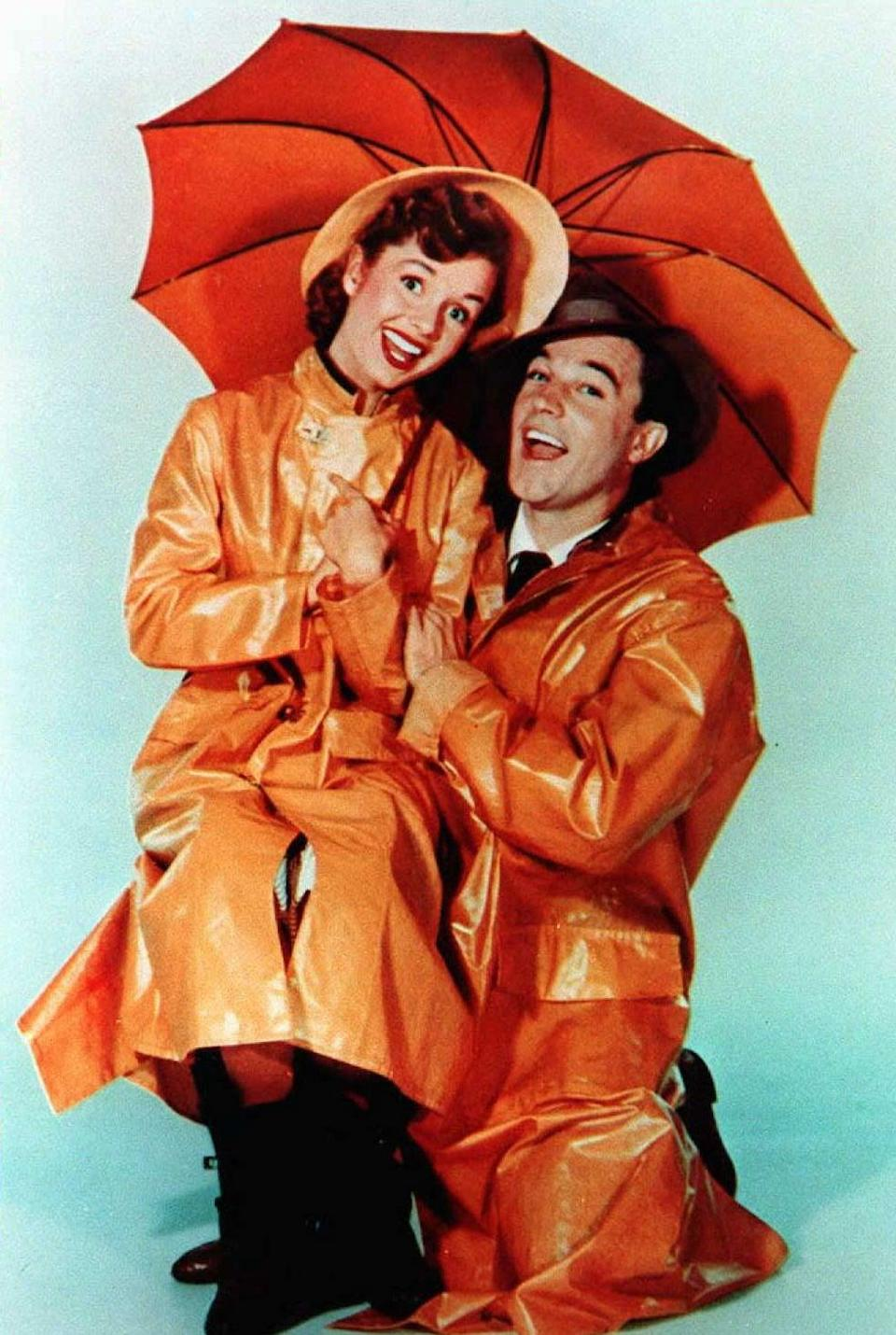 Debbie Reynolds and Gene Kelly's performances in Singin' in the Rain have gone down in Hollywood history (AFP via Getty Images)