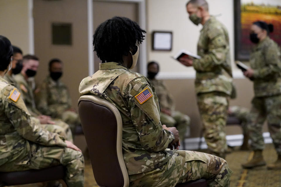 Soldiers give feedback to Sergeant Major of the Army Michael Grinston, second from right, and Sgt. Maj. Julie Guerra, People First Task Force, right, about their concerns at Fort Hood, Texas, Thursday, Jan. 7, 2021. Following more than two dozen soldier deaths in 2020, including multiple homicides, the U.S. Army Base is facing an issue of distrust among soldiers. (AP Photo/Eric Gay)