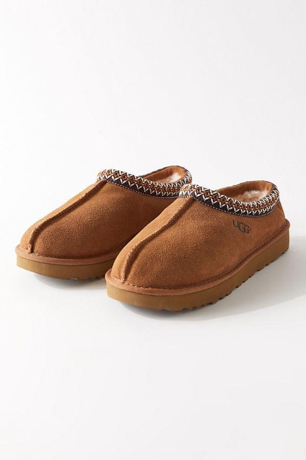 "It's UGG season, baby. Gift these cozy slippers to whomever in your life hasn't experience the wonders of UGGs embracing your feet and keeping them warm during the coldest of weathers. $100, Urban Outfitters. <a href=""https://www.urbanoutfitters.com/shop/ugg-tasman-slipper2?category=uo-ugg&color=020&quantity=1&type=REGULAR"">Get it now!</a>"