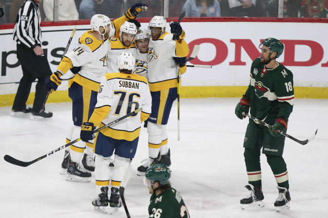 Nashville Predators' Mattias Ekholm (4), of Sweden, Nick Bonino (13), Rocco Grimaldi (23) and Wayne Simmonds (17) celebrate after Bonino scored a goal against the Minnesota Wild during the first period of an NHL hockey game Sunday, March 3, 2019, in St. Paul, Minn. (AP Photo/Stacy Bengs)