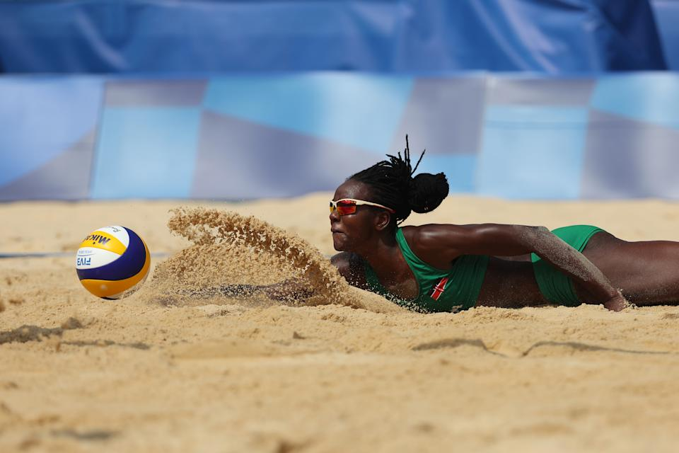 <p>Gaudencia Makokha #1 of Team Kenya attempts to dive for the ball against Team United States during the Women's Preliminary - Pool D beach volleyball on day six of the Tokyo 2020 Olympic Games at Shiokaze Park on July 29, 2021 in Tokyo, Japan. (Photo by Sean M. Haffey/Getty Images)</p>