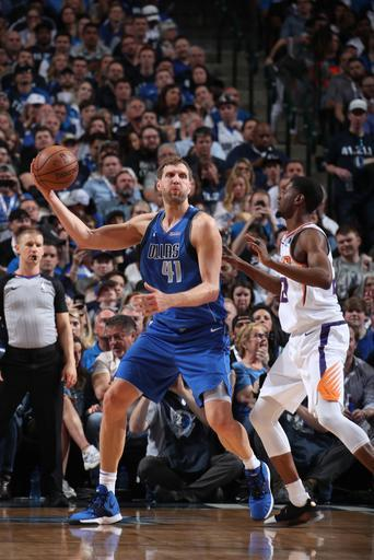 DALLAS, TX - APRIL 9: Dirk Nowitzki #41 of the Dallas Mavericks handles the ball against the Phoenix Suns on April 9, 2019 at American Airlines Center in Dallas, TX. (Photo by Nathaniel S. Butler/NBAE via Getty Images)