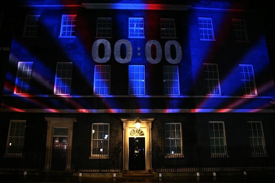 LONDON, ENGLAND - JANUARY 31: The Brexit countdown clock is projected onto Number 10 Downing Street on January 31, 2020 in London, United Kingdom. At 11.00pm on Friday 31st January the UK and Northern Ireland will exit the European Union, 188 weeks after the referendum on June 23rd, 2016. (Photo by Hollie Adams/Getty Images)