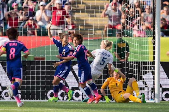 Japan's Yuki Ogimi (L) and Mana Iwabuchi celebrate after England scored an own-goal giving Japan the win in their semifinal match at the FIFA Women's World Cup in Edmonton, Canada on July 1, 2015 (AFP Photo/Geoff Robins)