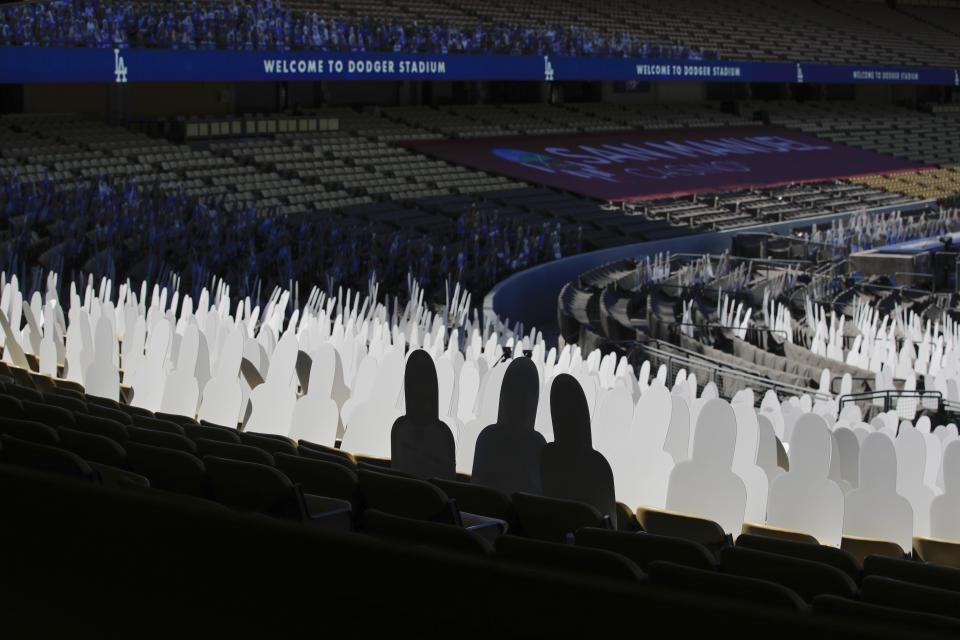 Cutouts occupy some of the stadium seats before a baseball game between the Los Angeles Dodgers and the San Francisco Giants, Sunday, July 26, 2020, in Los Angeles. (AP Photo/Jae C. Hong)