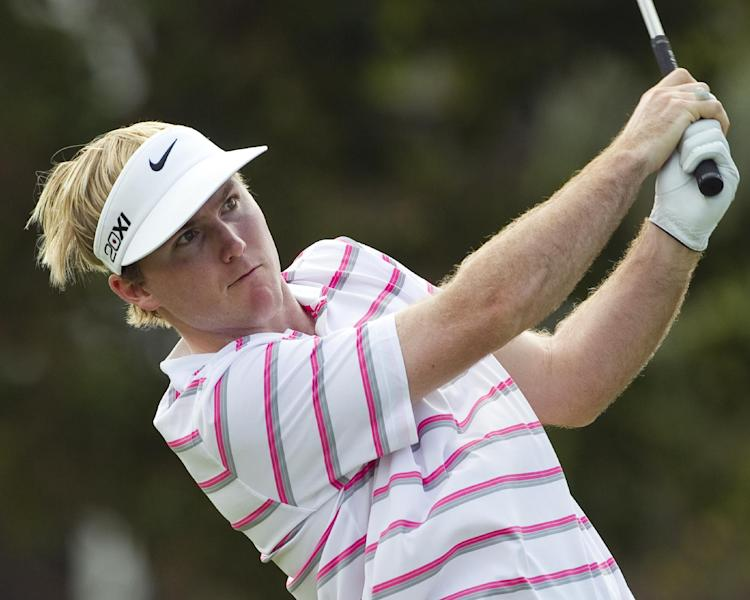 Russell Henley drives off the first tee during the second round of the Sony Open golf tournament, Friday, Jan. 11, 2013, in Honolulu. (AP Photo/Marco Garcia)