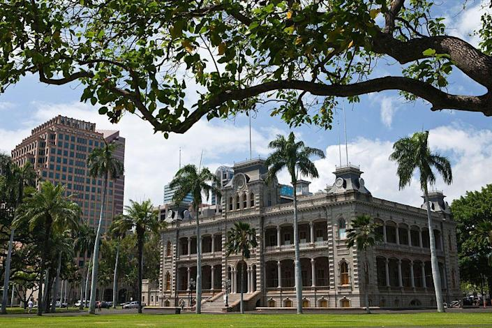 """<p>This <a href=""""https://www.iolanipalace.org/sacred-palace/"""" rel=""""nofollow noopener"""" target=""""_blank"""" data-ylk=""""slk:royal residence"""" class=""""link rapid-noclick-resp"""">royal residence</a> was built in 1882 by the last king of Hawaii, King Kalakaua. It remained that way until Queen Liliu'okalani, the king's sister and successor, was deposed and the Hawaiian monarchy was overthrown in January 1893. It's now a public museum, where security guards <a href=""""https://www.honolulumagazine.com/friday-night-frights-the-ghosts-who-haunt-hawaiis-historic-iolani-palace/"""" rel=""""nofollow noopener"""" target=""""_blank"""" data-ylk=""""slk:report"""" class=""""link rapid-noclick-resp"""">report</a> seeing the queen's ghostly figure and even the piano mysteriously playing in the Blue Room.</p>"""