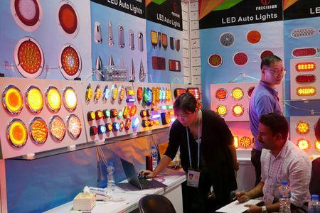 FILE PHOTO: LED lights are on display inside a booth at the Canton Fair in Guangzhou, China October 16, 2017. REUTERS/Venus Wu/File Photo
