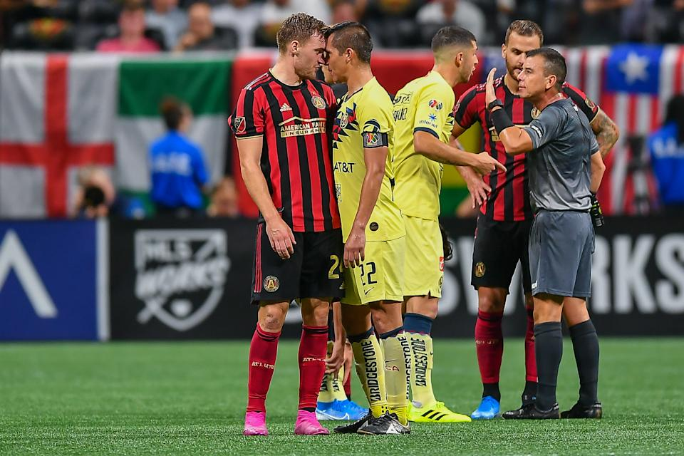 ATLANTA, GA  AUGUST 14:  Atlanta's Julian Gressel (24) and Club America's Paul Aguilar (22) are nose to nose during the Campeones Cup match between Club America and Atlanta United FC on August 14th, 2019 at Mercedes-Benz Stadium in Atlanta, GA.  (Photo by Rich von Biberstein/Icon Sportswire via Getty Images)
