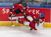 Canada's Dylan Holloway (10) checks Czech Republic's David Jiricek (8) during the second period of an IIHL World Junior Hockey Championship game, Saturday, Jan. 2, 2021 in Edmonton, Alberta. (Jason Franson/The Canadian Press via AP)
