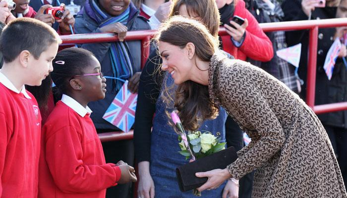 Catherine, Duchess of Cambridge meets children as she arrives at Rose Hill Primary School during a visit to Oxford on February 21, 2012 in Oxford, England. The visit is in association with the charity Art Room who work with children to increase self-confidence and self-esteem. (Photo by Chris Jackson/Getty Images)