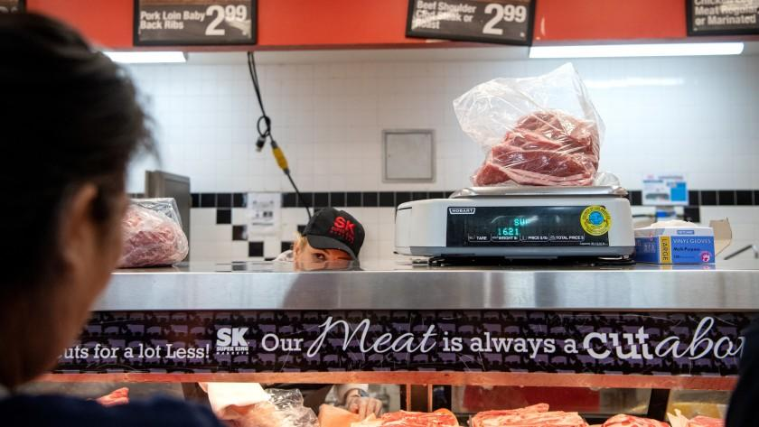 A bag of meat is weighed at the Glendale Super King market's butcher counter.