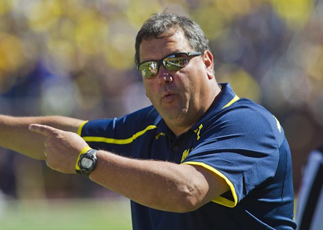 Michigan head coach Brady Hoke gestures and shouts instructions from the sideline during the fourth quarter of an NCAA college football game against Akron in Ann Arbor, Mich., Saturday, Sept. 14, 2013. Michigan won 28-24. (AP Photo/Tony Ding)