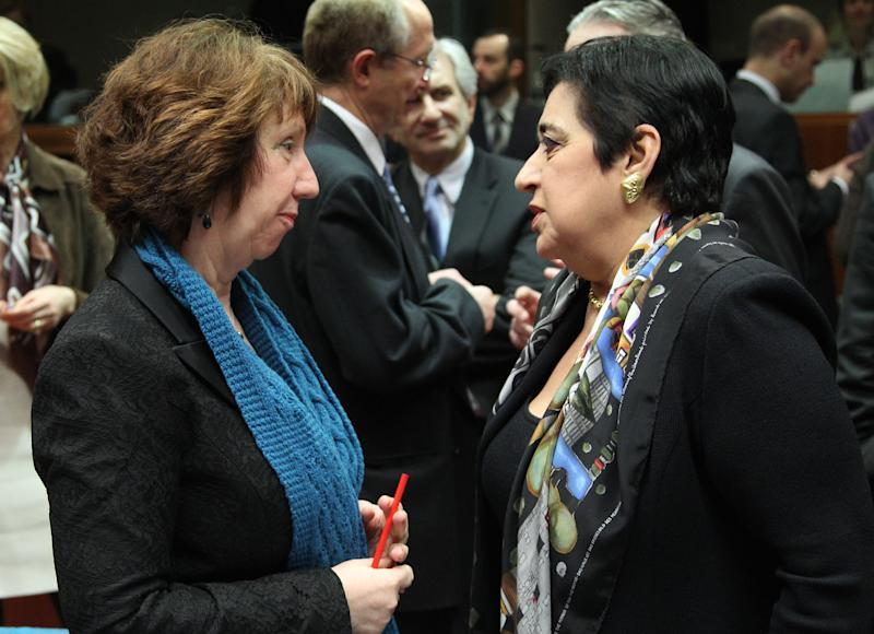 EU foreign policy chief Catherine Ashton, left, talks with Cypriot Foreign Minister Erato Kozakou-Markoullis, prior to the start of the EU foreign ministers meeting, at the European Council building in Brussels, Monday, Feb. 18, 2013. European Union foreign ministers were set Monday for a showdown over the bloc's arms embargo on Syria, while tighter sanctions on North Korea were expected to get waved through. (AP Photo/Yves Logghe)