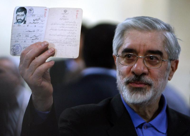 A file picture taken on May 9, 2009 shows Mir Hossein Mousavi flashing his identification card as he registers his candidacy for the presidential election