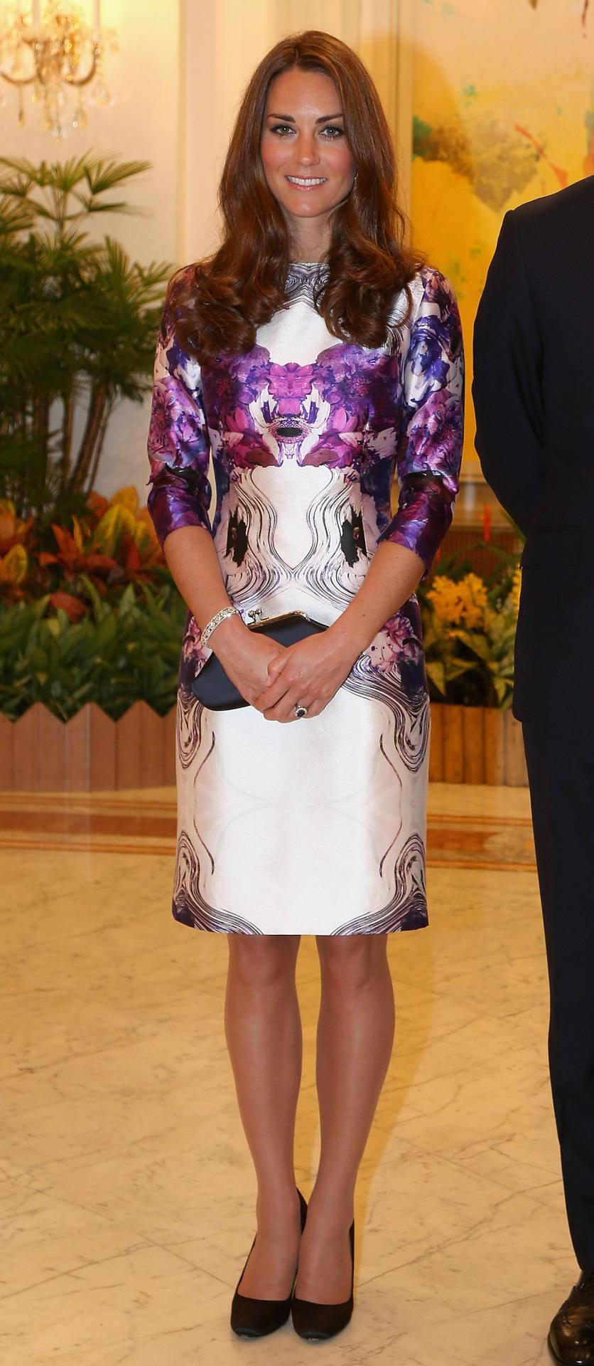 <p>Kate chose to wear Singapore's very own Prabal Gurung for her first day in the country. She opted for a floral design with a black Anya Hindmarch clutch and Prada pumps. </p><p><i>[Photo: PA]</i></p>