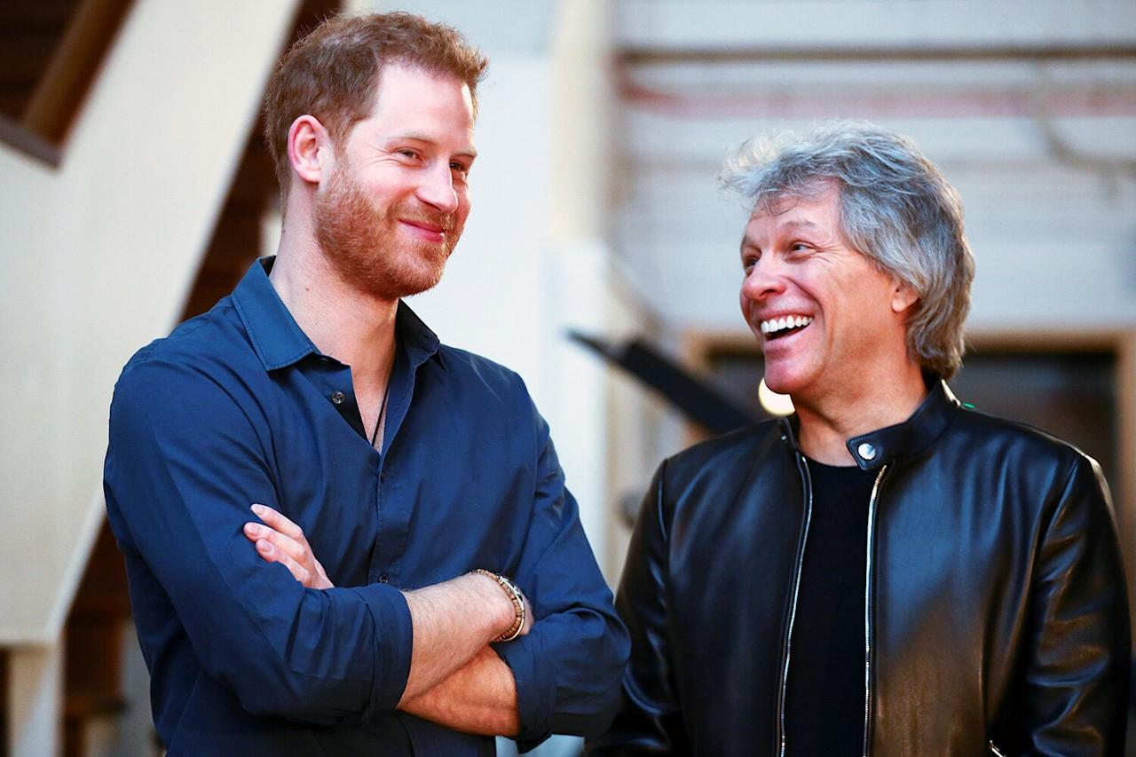 Prince Harry shares a laugh with Jon Bon Jovi at Abbey Road Studios on Friday in London.