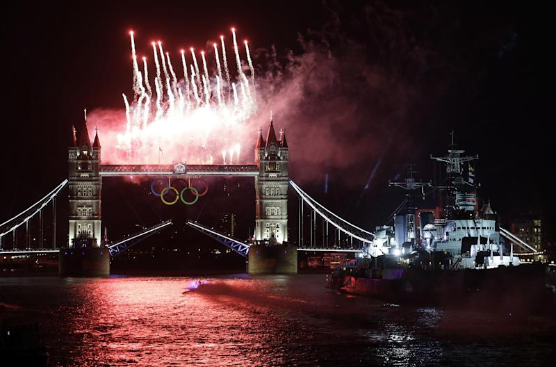 Fireworks illuminate the sky over the Tower Bridge and River Thames in London during the Opening Ceremony at the 2012 Summer Olympics, Friday, July 27, 2012, in London. (AP Photo/Lefteris Pitarakis)