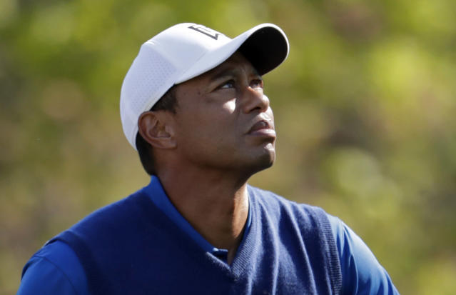 Tiger Woods prepares to tee off the 13th hole during the first round of the PGA Championship golf tournament, Thursday, May 16, 2019, at Bethpage Black in Farmingdale, N.Y. (AP Photo/Julio Cortez)