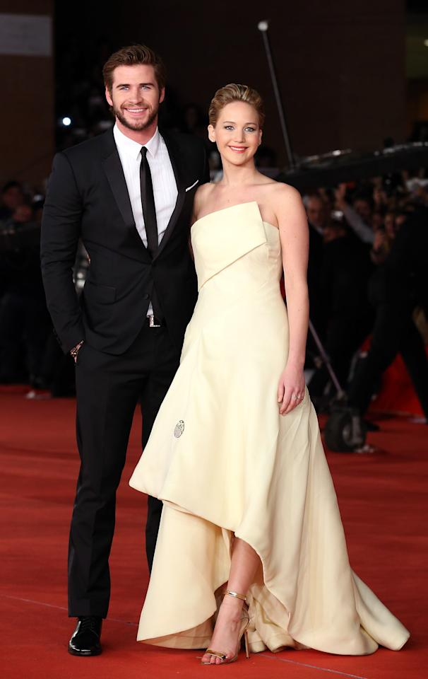 """<p>While Jen and Liam were never technically a full-blown couple (that we know of), the actress did admit to having feelings for the star while they filmed <a href=""""http://www.popsugar.com/The-Hunger-Games"""" target=""""_blank"""" class=""""ga-track"""" data-ga-category=""""Related"""" data-ga-label=""""http://www.popsugar.com/The-Hunger-Games"""" data-ga-action=""""In-Line Links"""">the Hunger Games</a> movies. During an appearance on <strong>Watch What Happens Live</strong> in December 2015, Jen revealed that <a href=""""https://www.popsugar.com/celebrity/Jennifer-Lawrence-Talks-About-Kissing-Liam-Hemsworth-2015-39505663"""" target=""""_blank"""" class=""""ga-track"""" data-ga-category=""""Related"""" data-ga-label=""""http://www.popsugar.com/celebrity/Jennifer-Lawrence-Talks-About-Kissing-Liam-Hemsworth-2015-39505663"""" data-ga-action=""""In-Line Links"""">she and Liam shared a few kisses off screen</a>. """"Liam and I grew up together,"""" she said. """"Liam's real hot. What would you have done?"""" While we know <a href=""""https://www.popsugar.com/celebrity/Miley-Cyrus-Liam-Hemsworth-Wedding-Pictures-45632218"""" target=""""_blank"""" class=""""ga-track"""" data-ga-category=""""Related"""" data-ga-label=""""https://www.popsugar.com/celebrity/Miley-Cyrus-Liam-Hemsworth-Wedding-Pictures-45632218"""" data-ga-action=""""In-Line Links"""">Liam is happily married to Miley Cyrus</a>, you do have to admit that he and Jen would have made an amazing couple.</p>"""