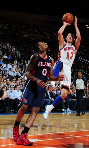 NEW YORK, NY - FEBRUARY 22: Jeremy Lin #17 of the New York Knicks goes to the basket against Jeff Teague #0 of the Atlanta Hawks during the game on February 22, 2012 at Madison Square Garden in New York City. (Photo by Scott Cunningham/NBAE via Getty Images)