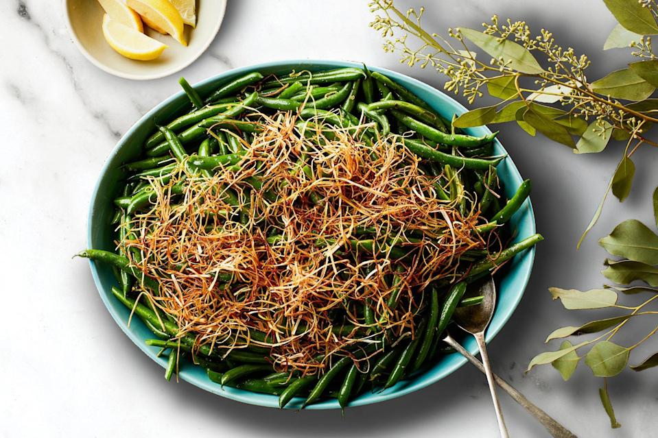 """Olive oil–fried leeks add crunch, flavor, and an impressive look to this classic green bean dish. It's great at <a href=""""https://www.epicurious.com/collection/thanksgiving-recipes-menus-strategies-tips?mbid=synd_yahoo_rss"""" rel=""""nofollow noopener"""" target=""""_blank"""" data-ylk=""""slk:Thanksgiving"""" class=""""link rapid-noclick-resp"""">Thanksgiving</a>, but there's no need to wait for November to enjoy it. <a href=""""https://www.epicurious.com/recipes/food/views/3-ingredient-lemony-green-beans-with-frizzled-leeks?mbid=synd_yahoo_rss"""" rel=""""nofollow noopener"""" target=""""_blank"""" data-ylk=""""slk:See recipe."""" class=""""link rapid-noclick-resp"""">See recipe.</a>"""