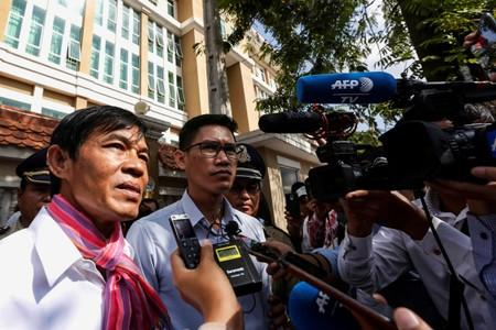 Uon Chhin and Yeang Sothearin, former journalists from the U.S.-funded Radio Free Asia (RFA), who have been charged with espionage, speak to the media in front of the Municipal Court of Phnom Penh after receiving their verdict, in Phnom Penh