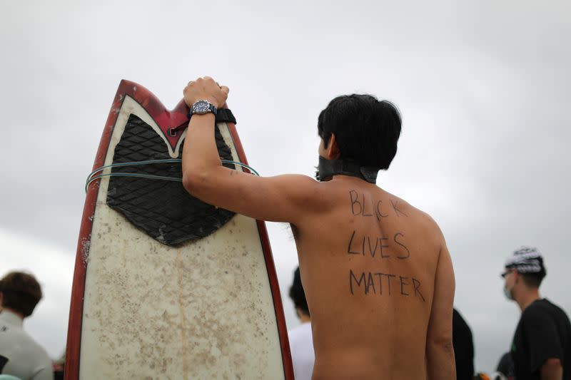 Panpan Wang, 37, attends the Black Girls Surf paddle-out in memory of George Floyd, who died in Minneapolis police custody, in Santa Monica