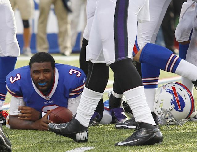 Buffalo Bills quarterback EJ Manuel (3) lies on the ground after his helmet was knocked off by the Baltimore Ravens defense near the end of an NFL football game Sunday, Sept. 29, 2013, in Orchard Park, N.Y. Buffalo won 23-20. (AP Photo/Bill Wippert)