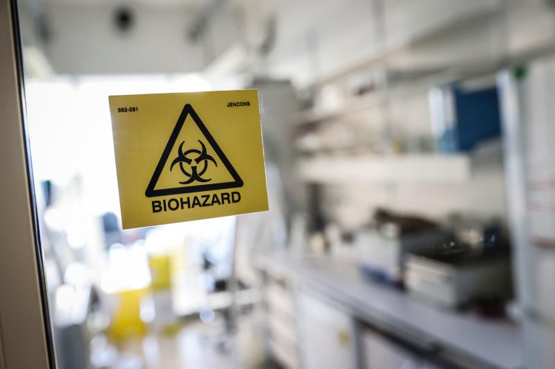A picture taken in a laboratory of the National Reference Center (CNR) for respiratory viruses at the Institut Pasteur in Paris on January 28, 2020 shows a biohazard sticker on the entrance of a room. - The CNR analyses the tests for respiratory viruses among which coronavirus. The deadly new coronavirus that has broken out in China, 2019-nCoV, has so far killed 106 people and infected over 4,000 -- the bulk of them in and around Wuhan. (Photo by Thomas SAMSON / AFP) (Photo by THOMAS SAMSON/AFP via Getty Images)