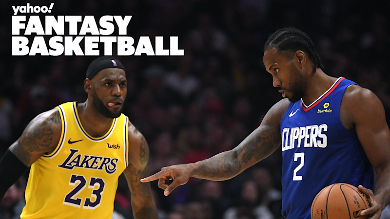 LOS ANGELES, CALIFORNIA - OCTOBER 22: Kawhi Leonard #2 of the LA Clippers controls possession of the ball in front of LeBron James #23 of the Los Angeles Lakers late in the fourth quarter in a 112-102 Clipper win during the LA Clippers season home opener at Staples Center on October 22, 2019 in Los Angeles, California. (Photo by Harry How/Getty Images)