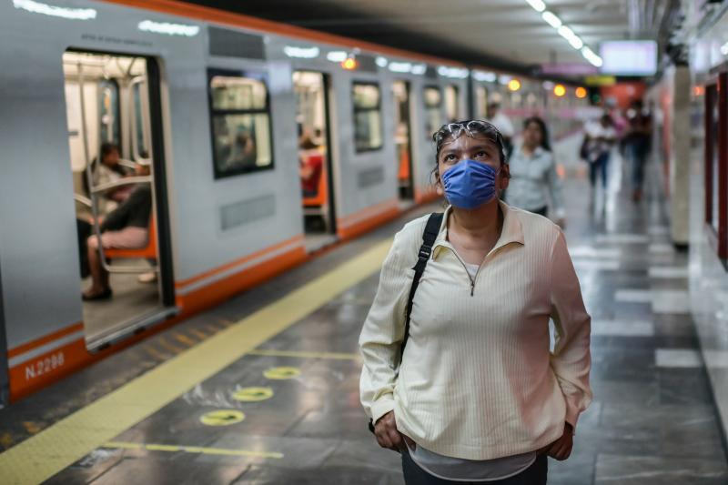 A woman wearing a face mask stands at the subway station in Mexico City, on April 2, 2020. - More than 20,000 cases of COVID-19 were registered in Latin America and the Caribbean by Wednesday -- double the figure from five days ago, according to an AFP tally. (Photo by PEDRO PARDO / AFP) (Photo by PEDRO PARDO/AFP via Getty Images)