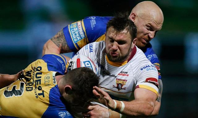"<span class=""element-image__caption"">Huddersfield's Paul Clough is wrapped up by Stevie Ward, left, and Keith Galloway in the Giants' surprise win against Leeds Rhinos at Headlingley.</span> <span class=""element-image__credit"">Photograph: Ed Sykes/Reuters</span>"