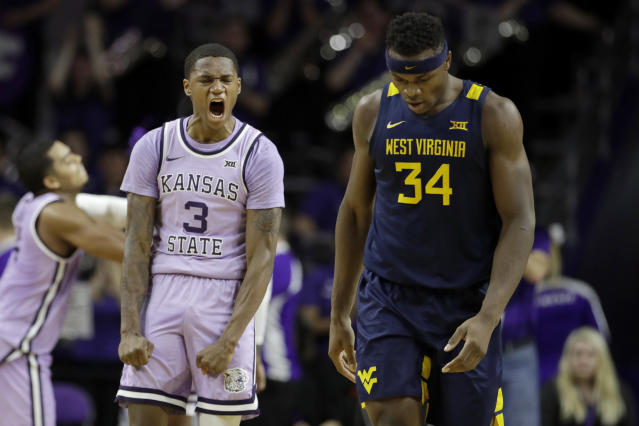 Kansas State's DaJuan Gordon (3) celebrates a basket as he walks down the court with West Virginia's Oscar Tshiebwe (34) during the first half of an NCAA college basketball game Saturday, Jan. 18, 2020 in Lawrence, Kan. Kansas State won 84-68 (AP Photo/Charlie Riedel)
