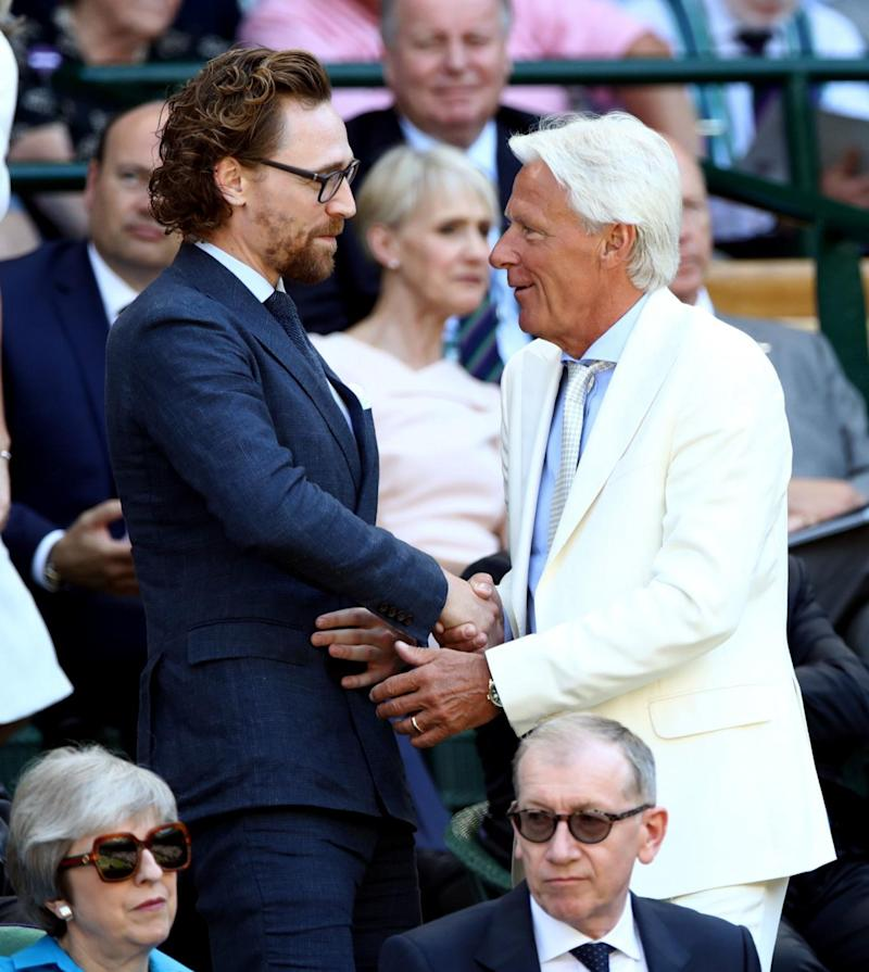 Tom Hiddleston (left) and Bjorn Borg in the royal box on centre court (PA)
